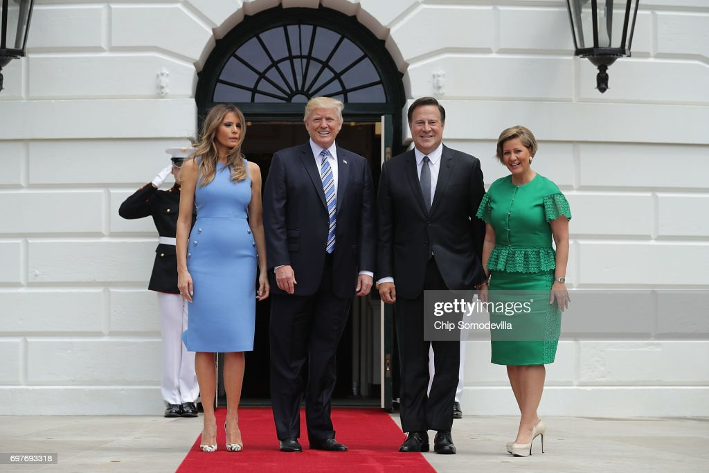 U.S. President Donald Trump and first lady Melania Trump (L) welcome Panamanian President Juan Carlos Varela (3rd L) and his wife Lorena Castillo Garcia de Varela to the White House June 19, 2017 in Washington, DC. According to the White House, the two presidents will hold meetings to talk about how to curb 'transnational organized crime, illegal migration, and illicit substances' and the continued political and economic instability in Venezuela.
