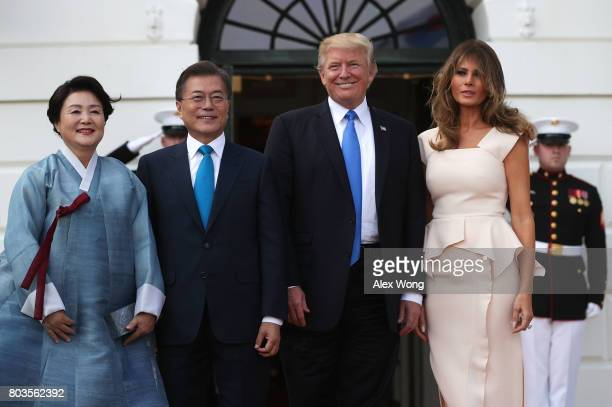 S President Donald Trump and first lady Melania Trump welcome South Korean President Moon Jaein and his wife Kim Jungsook during an arrival at the...