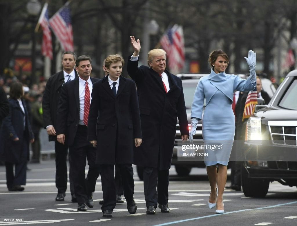 US President Donald Trump and First Lady Melania walk the inaugural parade route with son Barron on Pennsylvania Avenue in Washington, DC, on January 20, 2017 following swearing-in ceremonies on Capitol Hill earlier today. WATSON