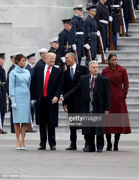 President Donald Trump and former president Barack Obama exchange words at the US Capitol with First Lady Melania Trump and Michelle Obamal on...