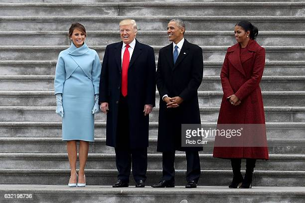 President Donald Trump and former president Barack Obama stand on the steps of the US Capitol with First Lady Melania Trump and Michelle Obamal on...