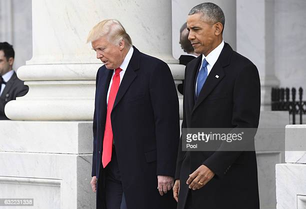 President Donald Trump and former President Barack Obama walk out prior to Obama's departure during the 2017 presidential inauguration at the US...