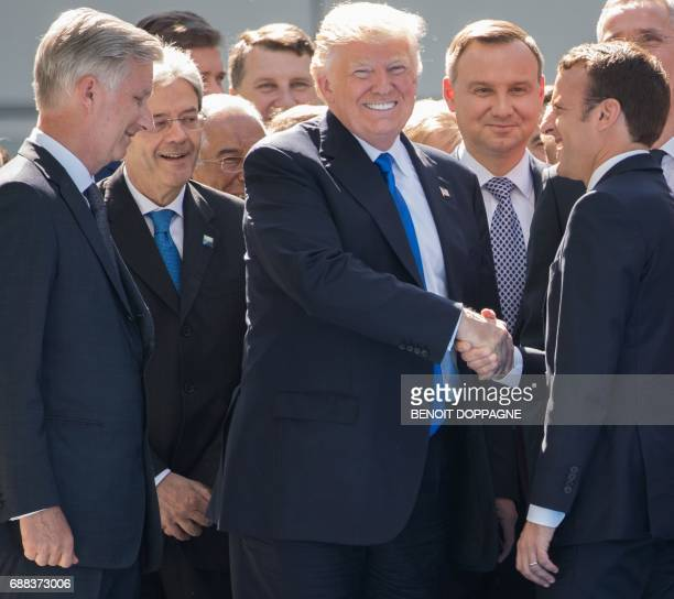 President Donald Trump and French President Emmanuel Macron during the unveiling ceremony of the new headquarters of NATO on May 25 2017 in Brussels...