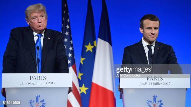US President Donald Trump and French President Emmanuel Macron hold a press conference following meetings at the Elysee Palace in Paris on July 13...