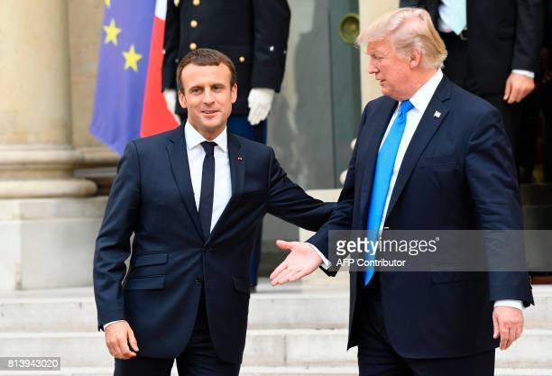 US President Donald Trump and French President Emmanuel Macron leave after a joint press conference following meetings at the Elysee Palace in Paris...