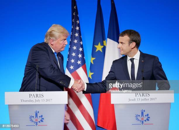 S President Donald Trump and French President Emmanuel Macron shake hands during a joint press conference after their meeting at the Elysee Palace in...