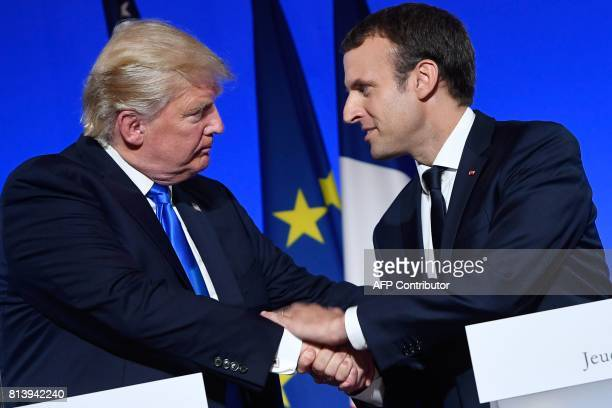 US President Donald Trump and French President Emmanuel Macron shake hand at the end of a press conference following meetings at the Elysee Palace in...