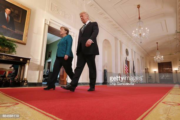 S President Donald Trump and German Chancellor Angela Merkel arrive for a joint press conference in the East Room of the White House March 17 2017 in...