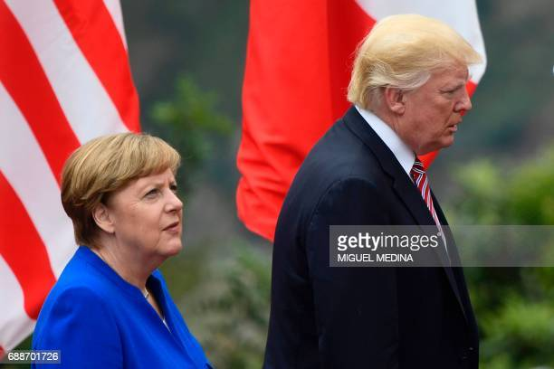 US President Donald Trump and German Chancellor Angela Merkel arrive for a family photo during the Summit of the Heads of State and of Government of...