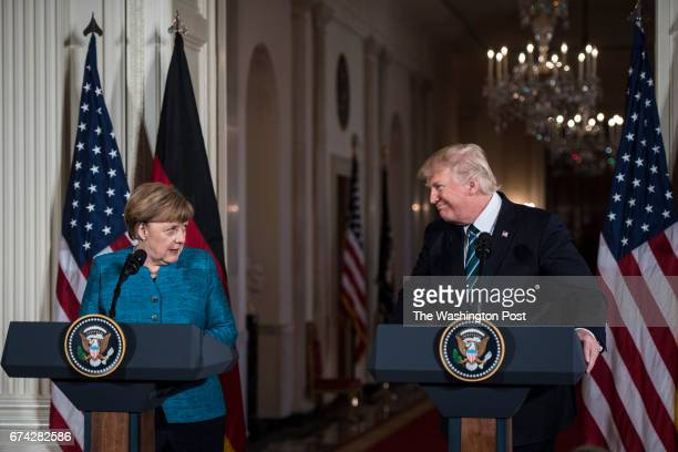 President Donald Trump and German Chancellor Angela Merkel participate in a joint news conference in the East Room of the White House in Washington...