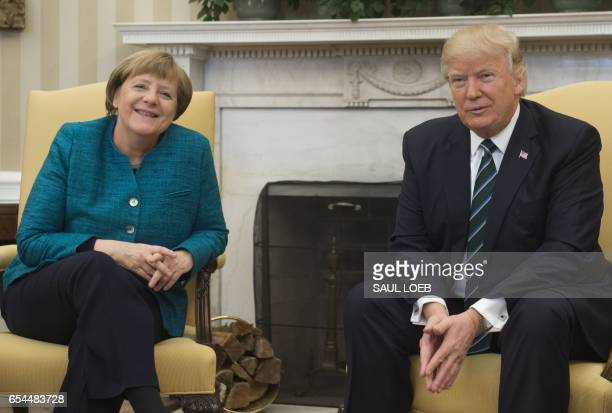 US President Donald Trump and German Chancellor Angela Merkel meet in the Oval Office of the White House in Washington DC on March 17 2017 / AFP...
