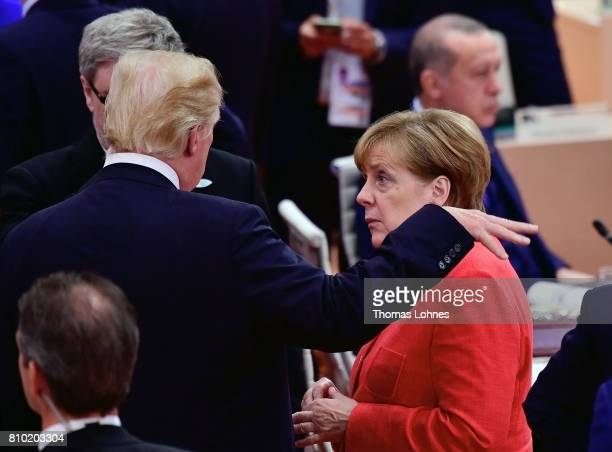 S President Donald Trump and German Chancellor Angela Merkel speak together when they arrive for the first woriking session of the G20 Nations Summit...
