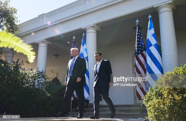 US President Donald Trump and Greece's Prime Minister Alexis Tsipras arrive for a joint press conference in the Rose Garden of the White House on...