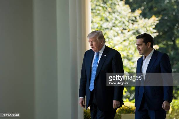 US President Donald Trump and Greek Prime Minister Alexis Tsipras arrive for a joint press conference in the Rose Garden at the White House October...