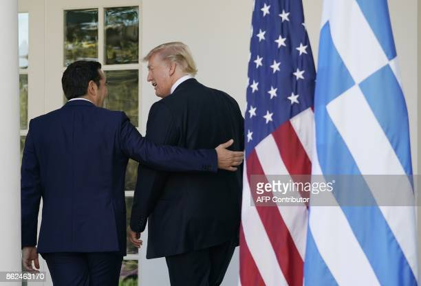 US President Donald Trump and Greek Prime Minister Alexis Tsipras return to the Oval Office following a joint press conference in the Rose Garden of...