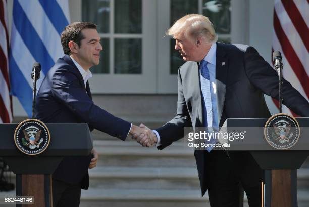 S President Donald Trump and Greek Prime Minister Alexis Tsipras shake hands during a joint press conference in the Rose Gard at the White House...