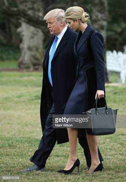 S President Donald Trump and his daughter Ivanka Trump walk toward Marine One while departing from the White House on February 1 2017 in Washington...