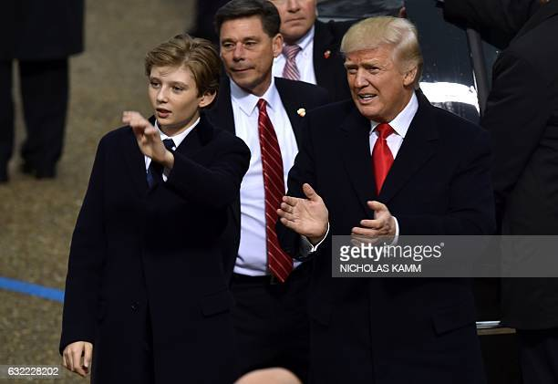 US President Donald Trump and his son Baron arrive in front of the White House for the presidential inaugural parade on January 20 2017 in Washington...