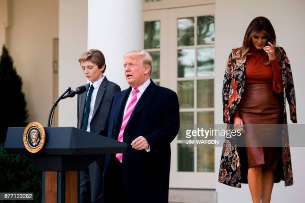 US President Donald Trump and his son Barron speaks alongside First Lady Melania Trump before pardoning the Thanksgiving turkey Drumstick in the Rose...