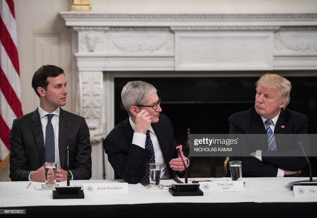US President Donald Trump (R) and his son-in-law and senior adviser Jared Kushner (L) listen to Apple CEO Tim Cook (C) during an American Technology Council roundtable at the White House in Washington, DC, on June 19, 2017. /
