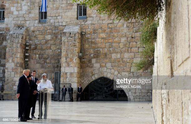 US President Donald Trump and his soninlaw and senior advisor Jared Kushner listen to Rabbi Shmuel Rabinovitch during a visit to the Western Wall the...