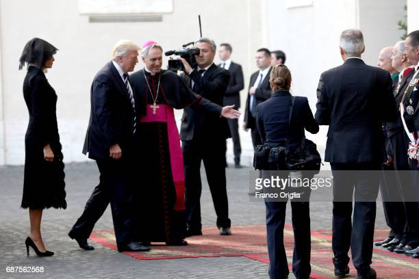 President Donald Trump and his wife First Lady Melania Trump are welcomed by the prefect of the papal household Georg Gaenswein as they arrive at the...
