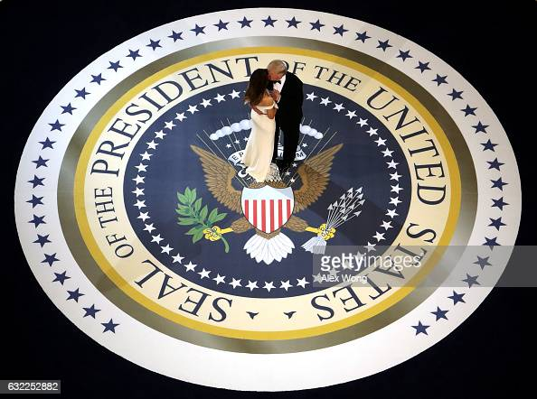 President Donald Trump and his wife First Lady Melania Trump kiss and dance on stage during A Salute To Our Armed Services Inaugural Ball at the...