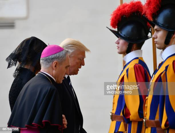 US President Donald Trump and his wife Melania are welcomed by the prefect of the papal household Georg Gaenswein as they arrive at the Vatican for a...