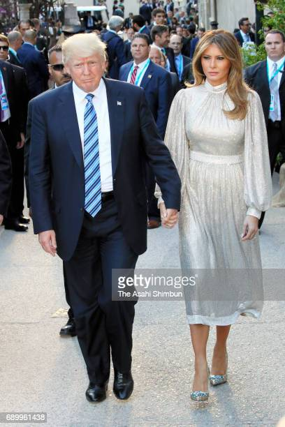 US President Donald Trump and his wife Melania arrive at the Teatro Greco for a concert during the first day of the G7 Summit on May 26 2017 in...