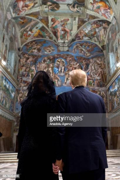 US President Donald Trump and his wife Melania Trump are seen as they visit the Sistine Chapel in Vatican City on May 24 2017