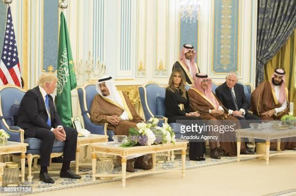 US President Donald Trump and his wife Melania Trump are seen during a meeting with Saudi Arabia's King Salman bin Abdulaziz Al Saud at AlYamamah...