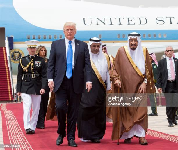 US President Donald Trump and his wife Melania Trump are welcomed by Saudi Arabia's King Salman bin Abdulaziz Al Saud during their arrival at the...