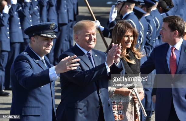 S President Donald Trump and his wife Melania Trump are welcomed with an official ceremony upon their arrival at Yokota Air Base in Tokyo Japan on...