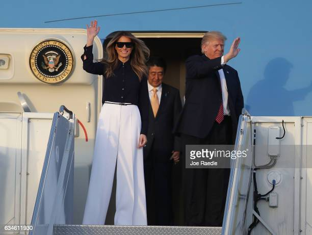 President Donald Trump and his wife Melania Trump arrive with Japanese Prime Minister Shinzo Abe on Air Force One at the Palm Beach International...