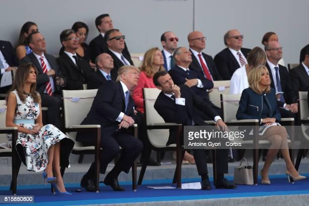 President Donald Trump and his wife Melania Trump French President Emmanuel Macron and his wife Brigitte Trogneux congratul the traditional Bastille...