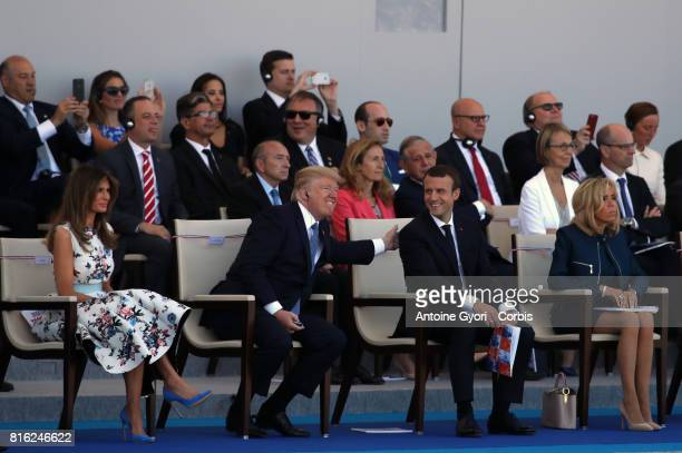 President Donald Trump and his wife Melania Trump French President Emmanuel Macron and his wife Brigitte Trogneux during the traditional Bastille day...