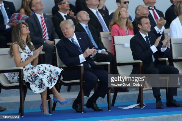 President Donald Trump and his wife Melania Trump French President Emmanuel Macron during the traditional Bastille day military parade on the...