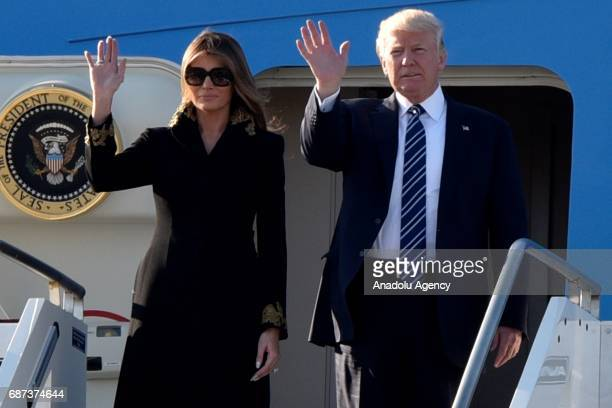 President Donald Trump and his wife Melania Trump gesture as they arrive at Fiumicino airport in Rome Italy on May 23 2017