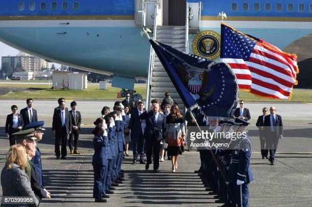S President Donald Trump and his wife Melania Trump walk past honor guards upon their arrival at Yokota Air Base in Tokyo Japan on November 5 2017