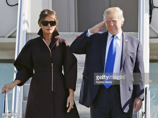 US President Donald Trump and his wife Melania wave as they leave Yokota Air Base in Tokyo on Nov 7 for South Korea the second leg of his fivecountry...