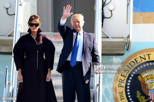 US President Donald Trump and his wife Melania wave on departure to South Korea at Yokota Air Base on November 7 2017 in Fussa Tokyo Japan Trump is...
