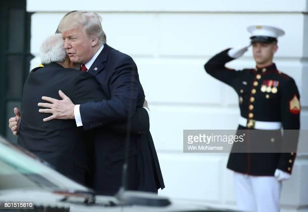 S President Donald Trump and Indian Prime Minister Narendra Modi embrace as Modi departs the White House June 26 2017 in Washington DC Trump and Modi...