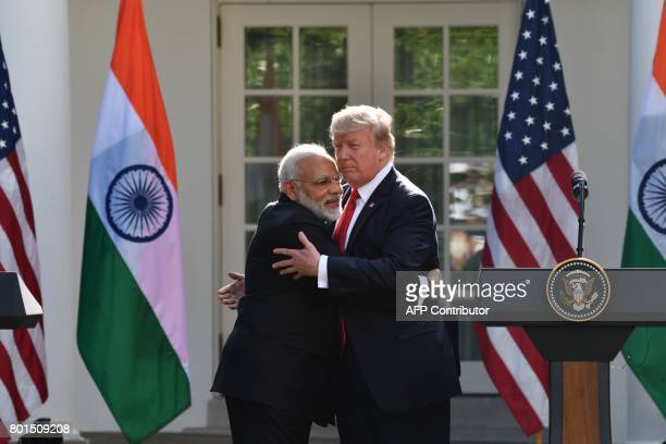 US President Donald Trump and Indian Prime Minister Narendra Modi embrace in the Rose Garden during a joint press conference at the White House in...