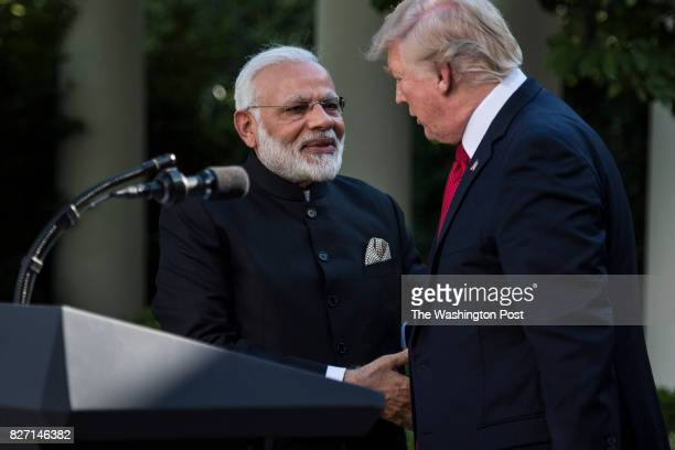 President Donald Trump and Indian Prime Minister Narendra Modi shake hands while making statements in the Rose Garden of the White House in...
