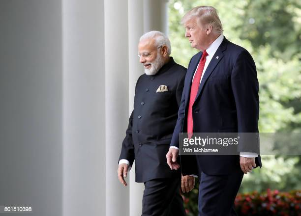 S President Donald Trump and Indian Prime Minister Narendra Modi walk from the Oval Office to deliver joint statements in the Rose Garden of the...