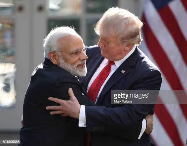 S President Donald Trump and Indian Prime Minister Narendra Modi embrace while delivering joint statements in the Rose Garden of the White House June...