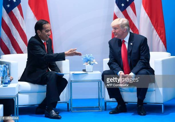 US President Donald Trump and Indonesia's President Joko Widodo hold a meeting on the sidelines of the G20 Summit in Hamburg Germany July 8 2017...