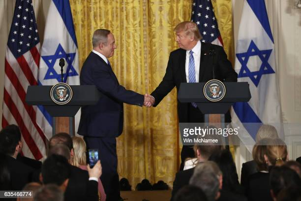 US President Donald Trump and Israel Prime Minister Benjamin Netanyahu shake hands during a joint news conference at the East Room of the White House...