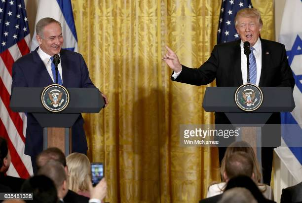 S President Donald Trump and Israel Prime Minister Benjamin Netanyahu answer questions during a joint news conference in the East Room of the White...