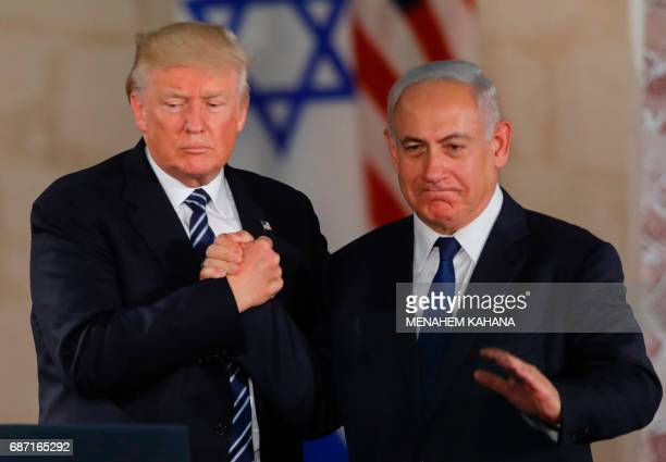 US President Donald Trump and Israel's Prime Minister Benjamin Netanyahu shake hands after delivering a speech at the Israel Museum in Jerusalem on...